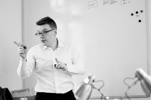 Jordan Greenaway, Managing Director of Transmission Private, standing at a whiteboard