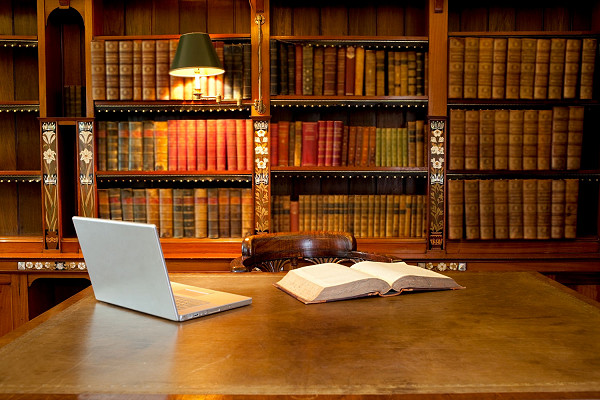 Laptop and book on a desk